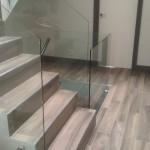 Wood grained porcelain tile and Glass Ballustrades